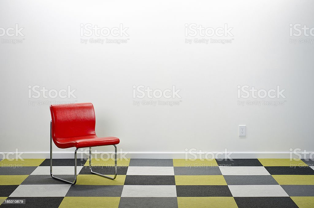 Modern Room With Checkered Carpeting & Red Chair royalty-free stock photo