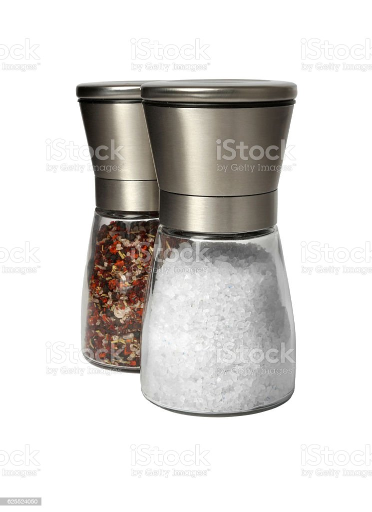 Modern salt and pepper mills isolated on white stock photo