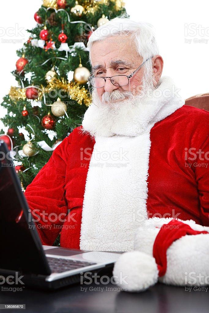 modern Santa using laptop royalty-free stock photo
