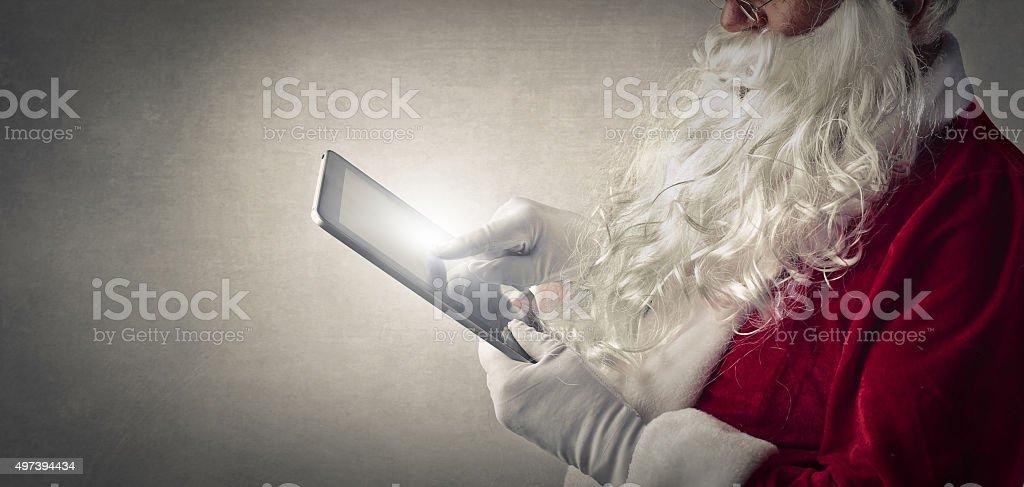 Modern Santa's list stock photo