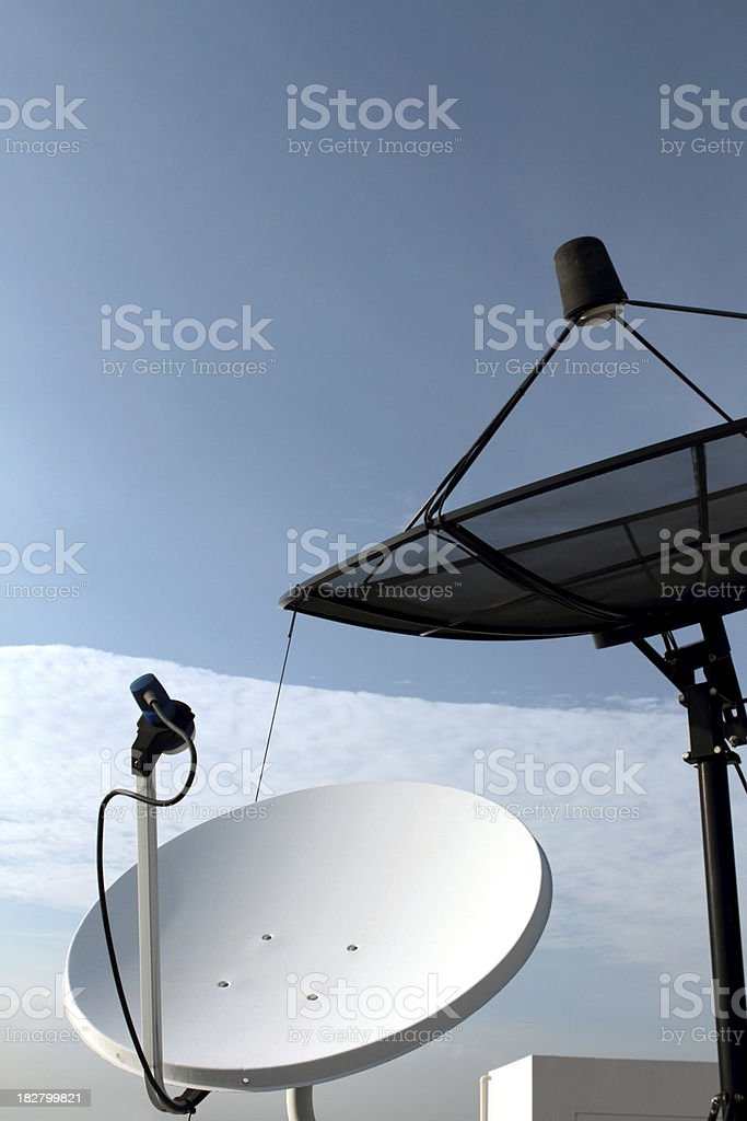 Modern satellite dish against blue sky royalty-free stock photo