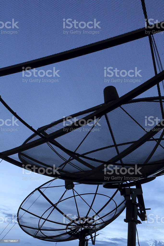 Modern satellite dish at dusk against blue sky royalty-free stock photo