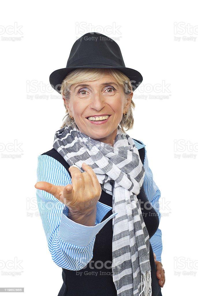 Modern senior woman invites you stock photo