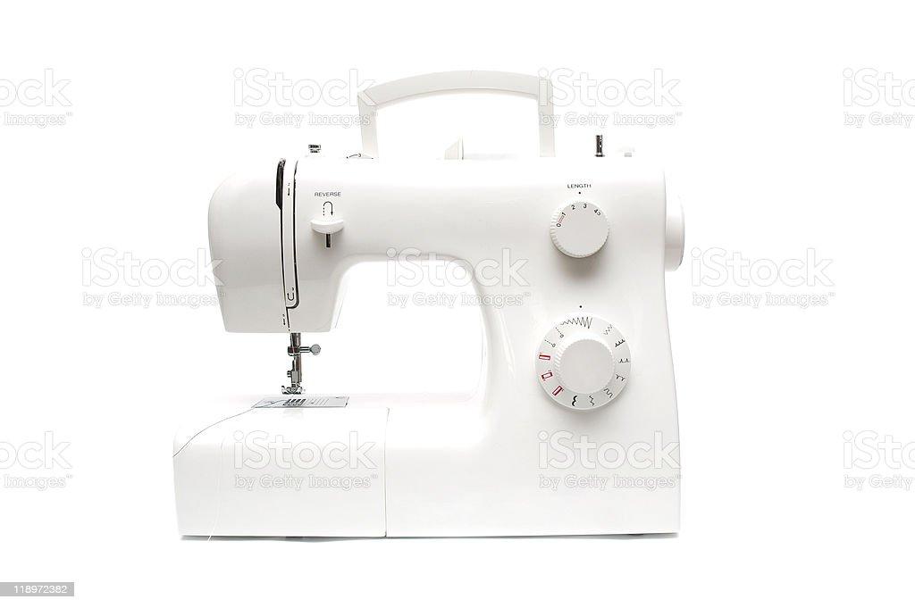 Modern sewing-machine on white background royalty-free stock photo