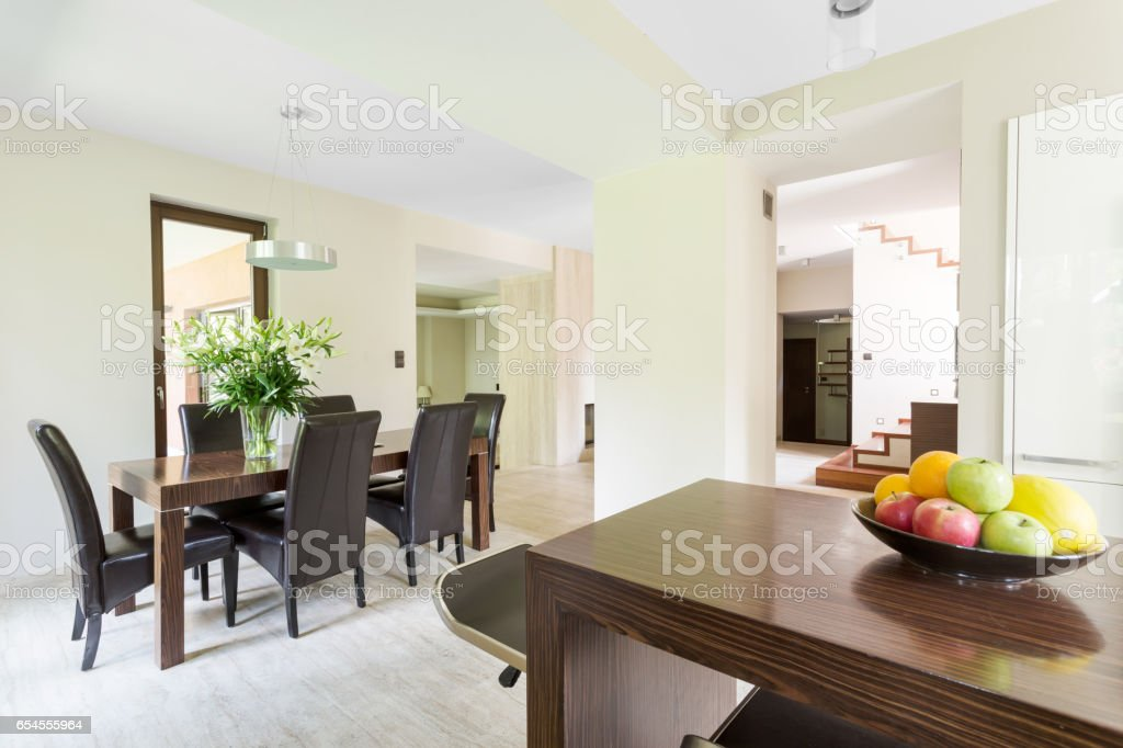 Modern shape of a luxurious dining room in travertine stock photo