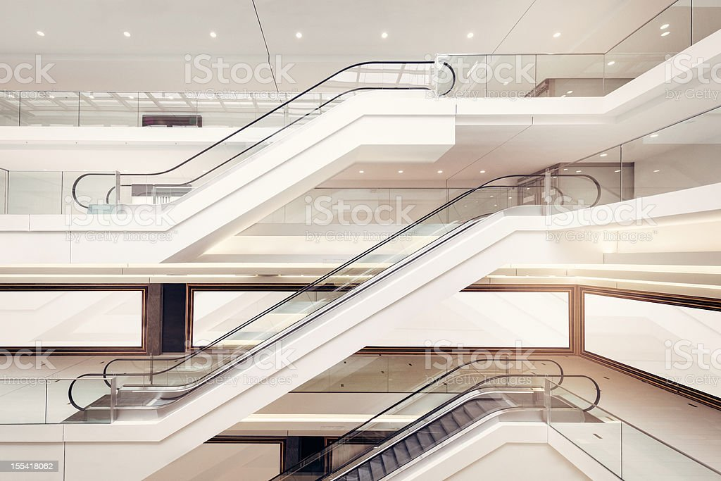 Modern shopping mall escalators stock photo