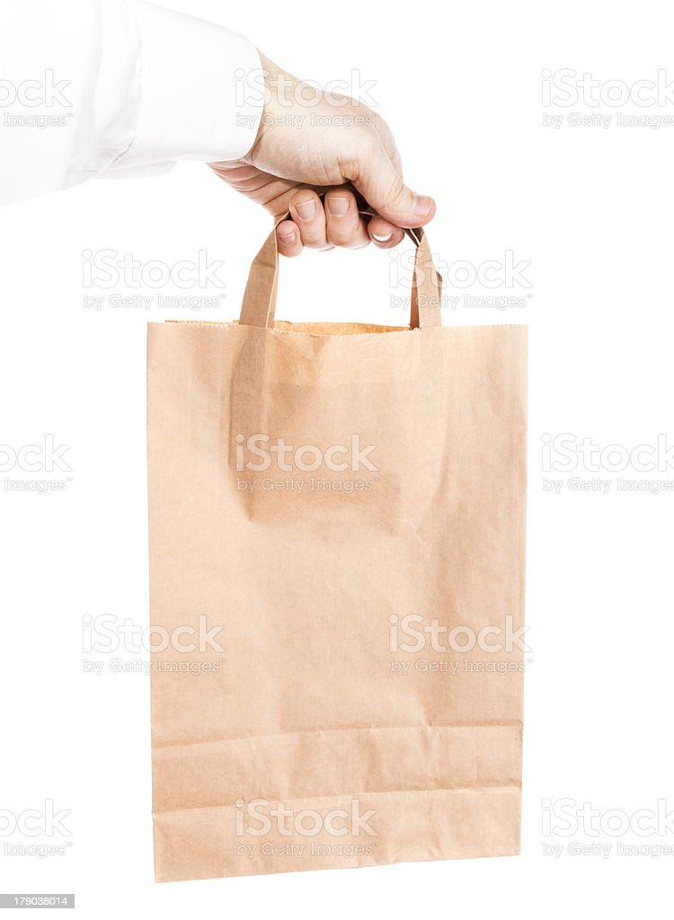 Modern shopping paper bag in male hand isolated on white royalty-free stock photo