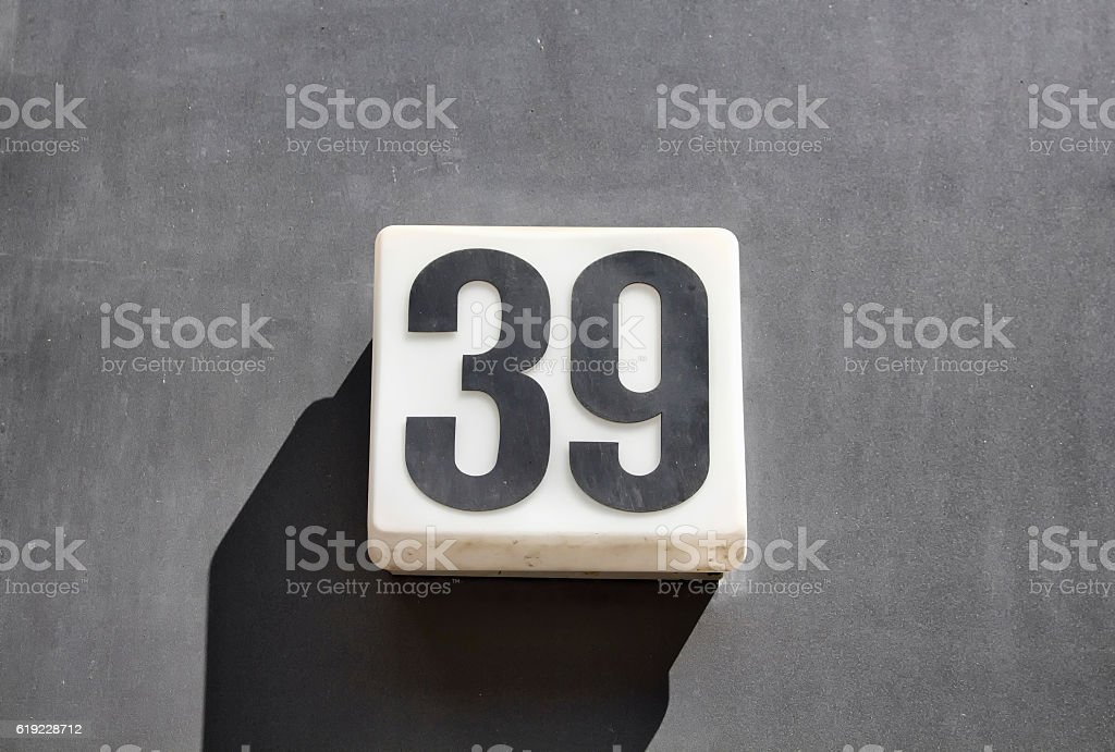 Modern, simple, monochromatic building number stock photo