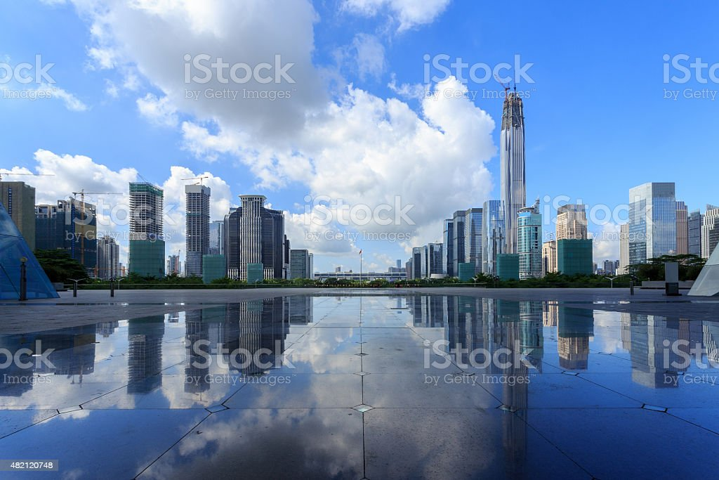 Modern skyline and buildings with empty square floor stock photo