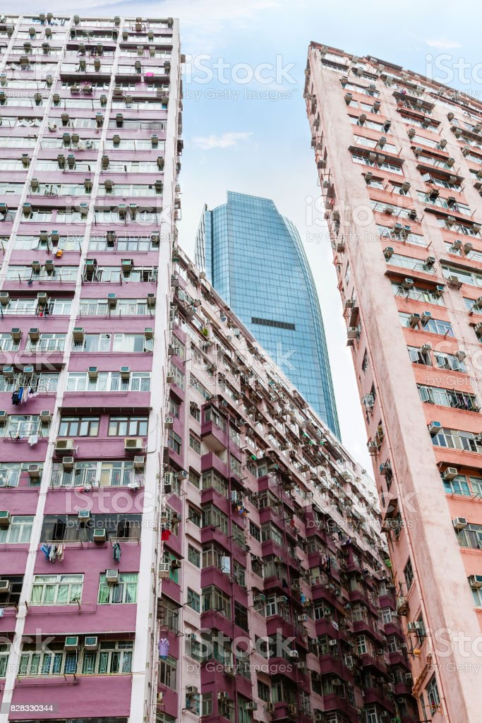 Modern Skyscraper Rises Above Old Buildings in Hong Kong stock photo