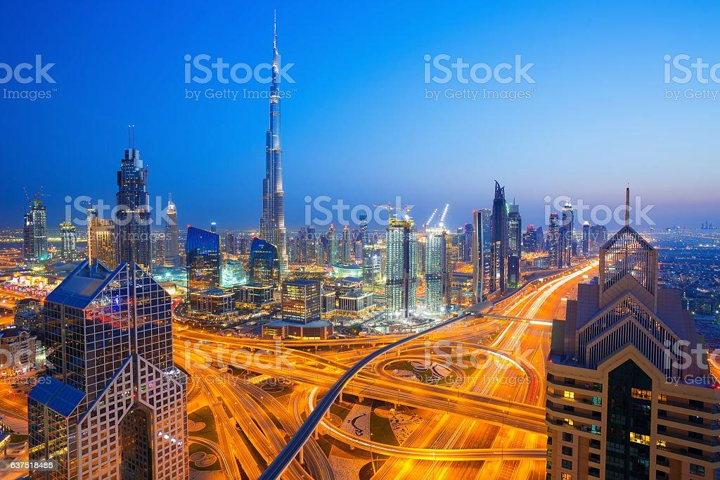 Modern skyscrapers, busy evening highways in luxury Dubai city,UAE stock photo