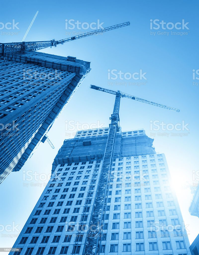Modern skyscrapers in a blue construction site royalty-free stock photo