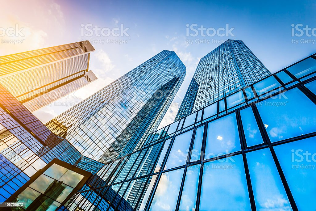 Modern skyscrapers in business district at sunset stock photo