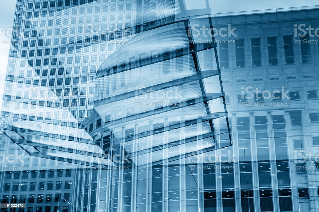 Modern skyscrapers reflecting in one another in glass walls stock photo