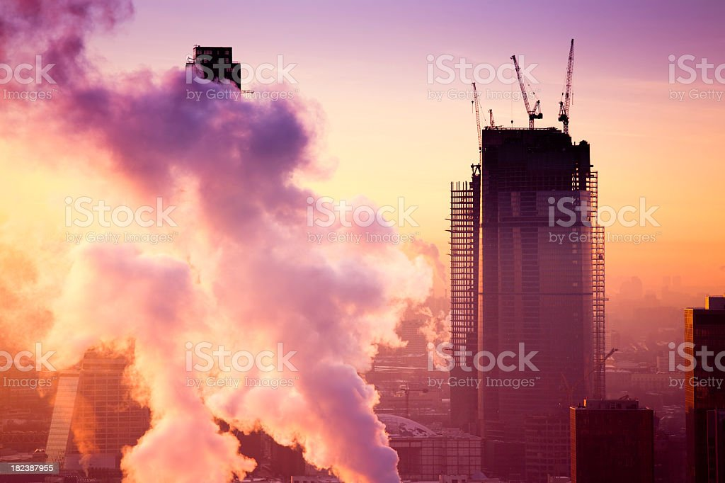 Modern skyscrapers under construction at sunset royalty-free stock photo