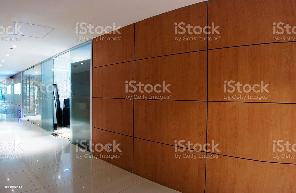 A modern, sleek office corridor stock photo