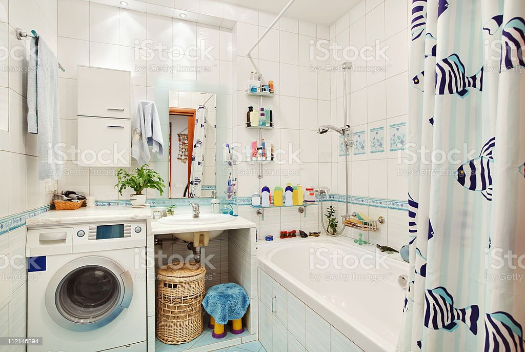 Modern small bathroom in blue colors wide angle view royalty-free stock photo
