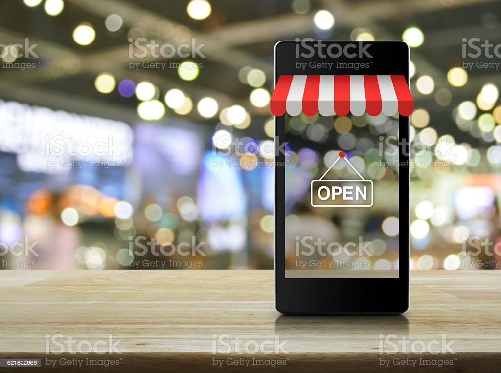Modern smart mobile phone with on line shopping store graphic stock photo