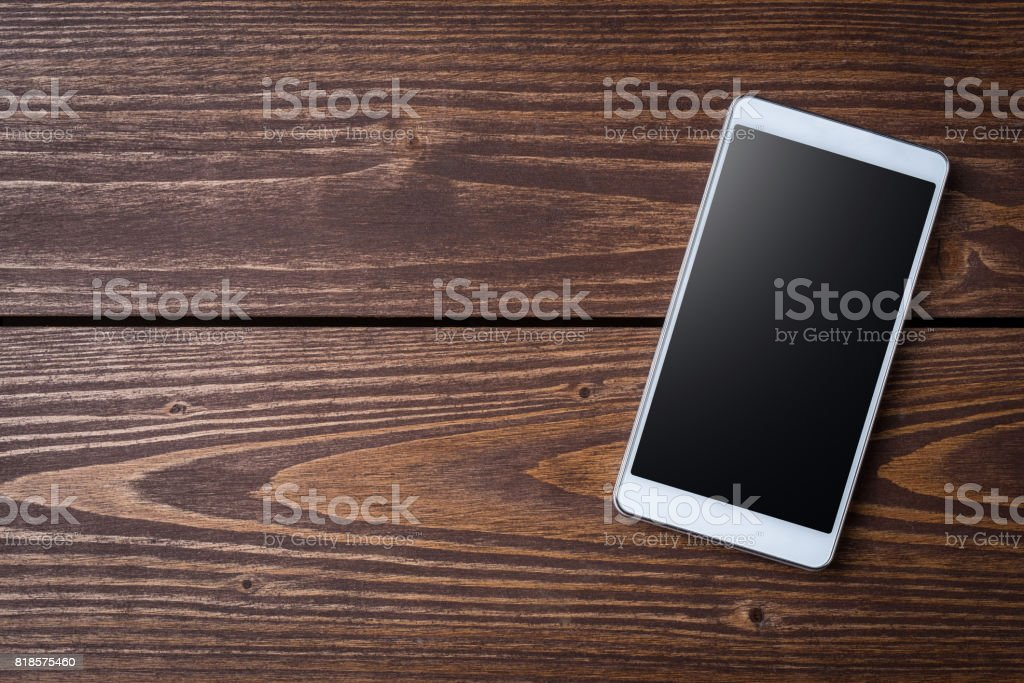 Modern smart phone on wooden table stock photo