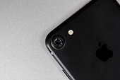 Modern smartphone with damaged camera lens