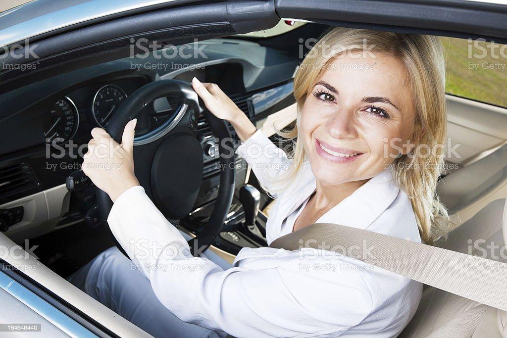 Modern smiling female enjoying in a car ride. stock photo