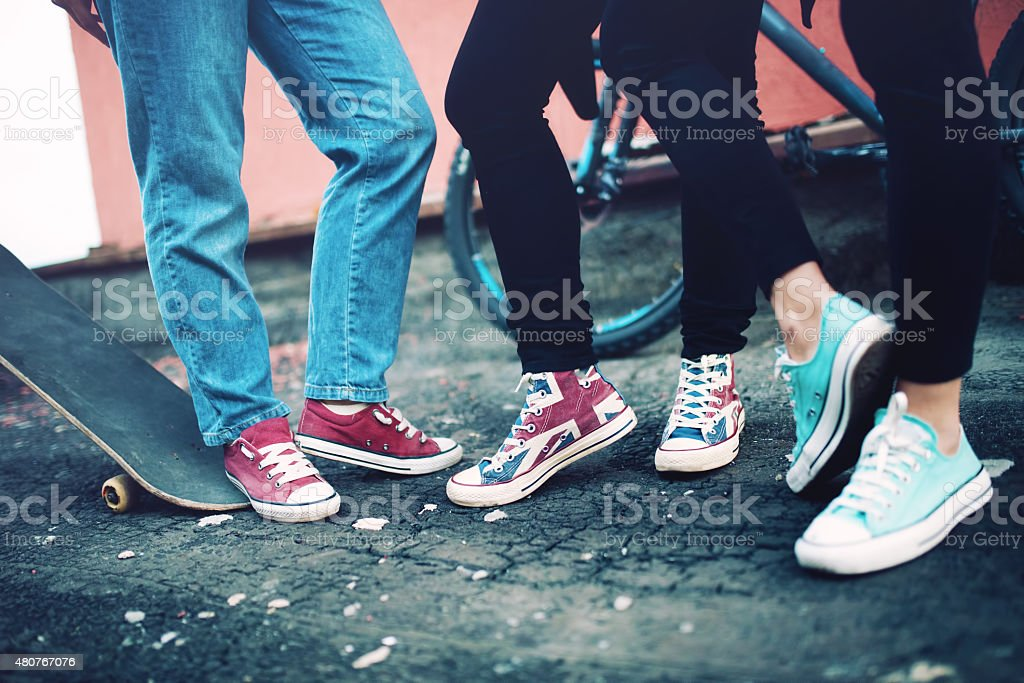 modern sneakers worn by friends, urban lifestyle of modern clothing stock photo