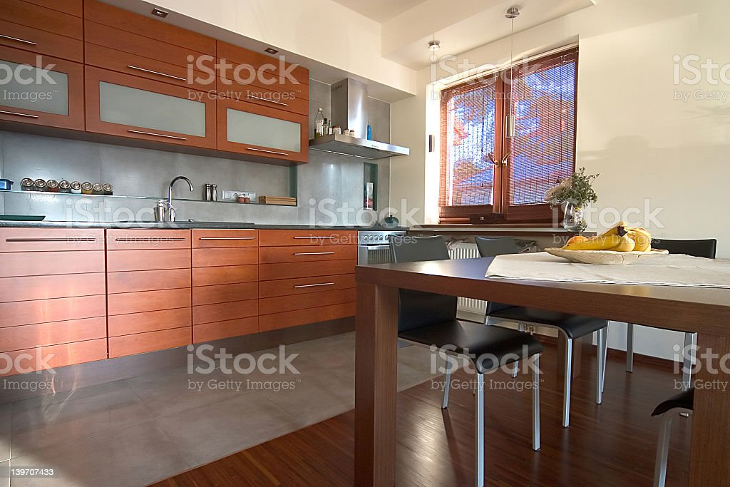 Modern spacious kitchen with wooden cabinets royalty-free stock photo