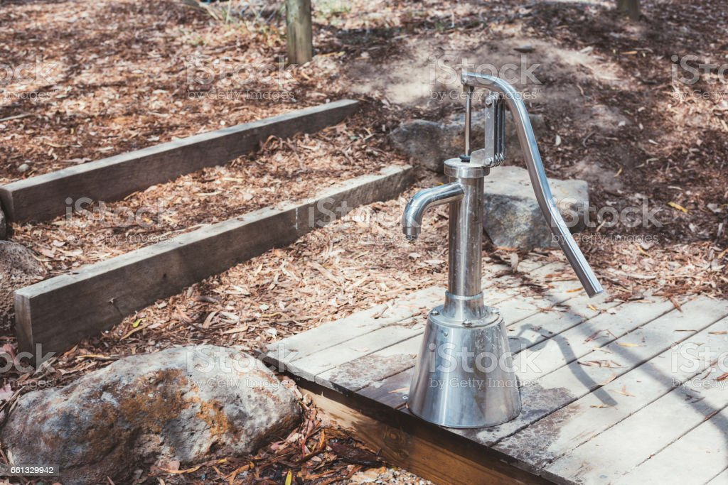 Modern stainess steel hand water pump in Melbourne country, Australia. stock photo