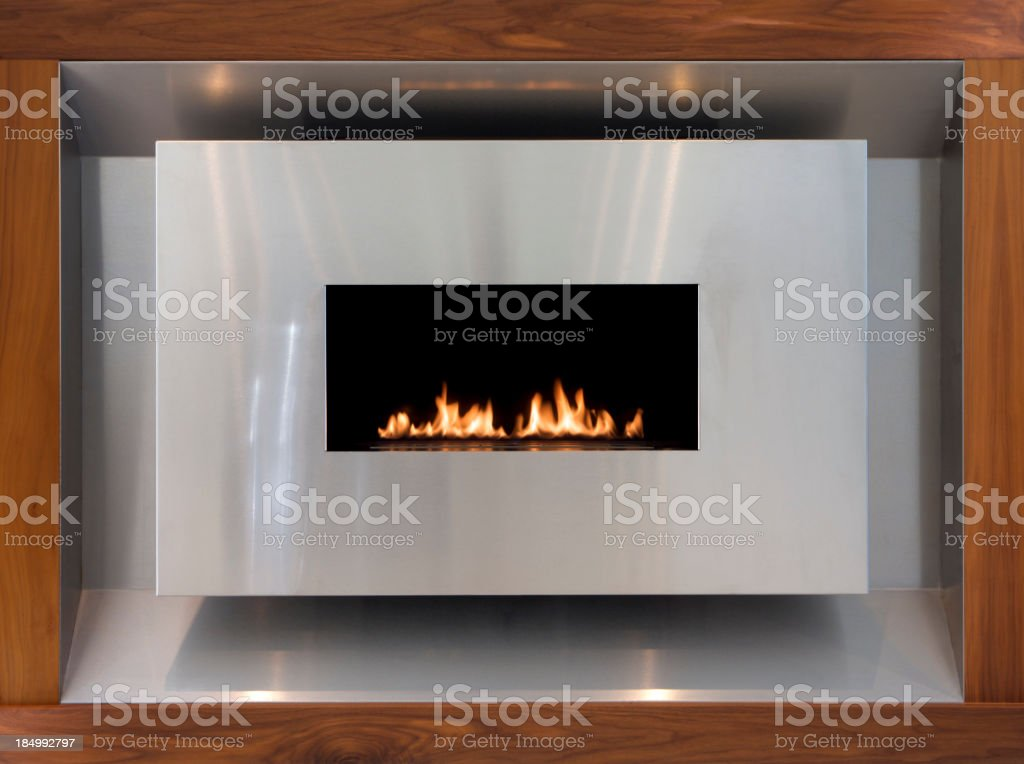 modern stainless steel and walnut gas fire stock photo