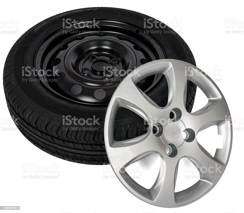 Modern steel car wheel with plastic cover stock photo