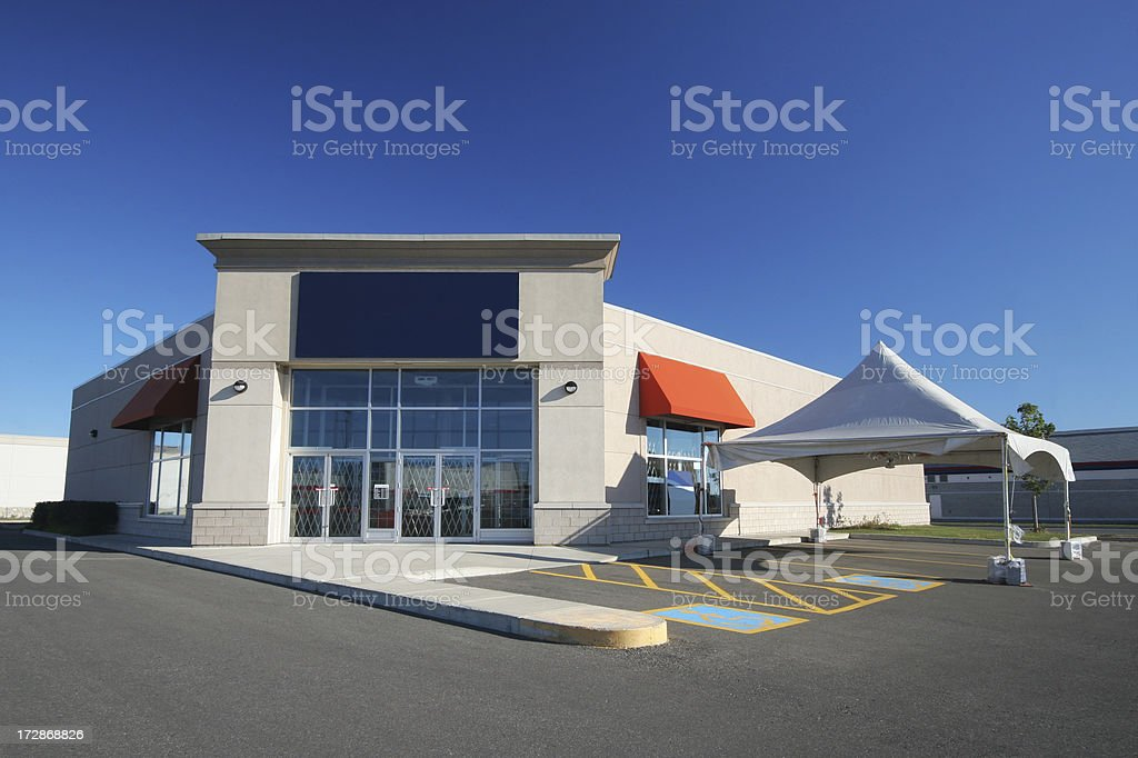 Modern Store Building with a white marquee promotion Tent royalty-free stock photo