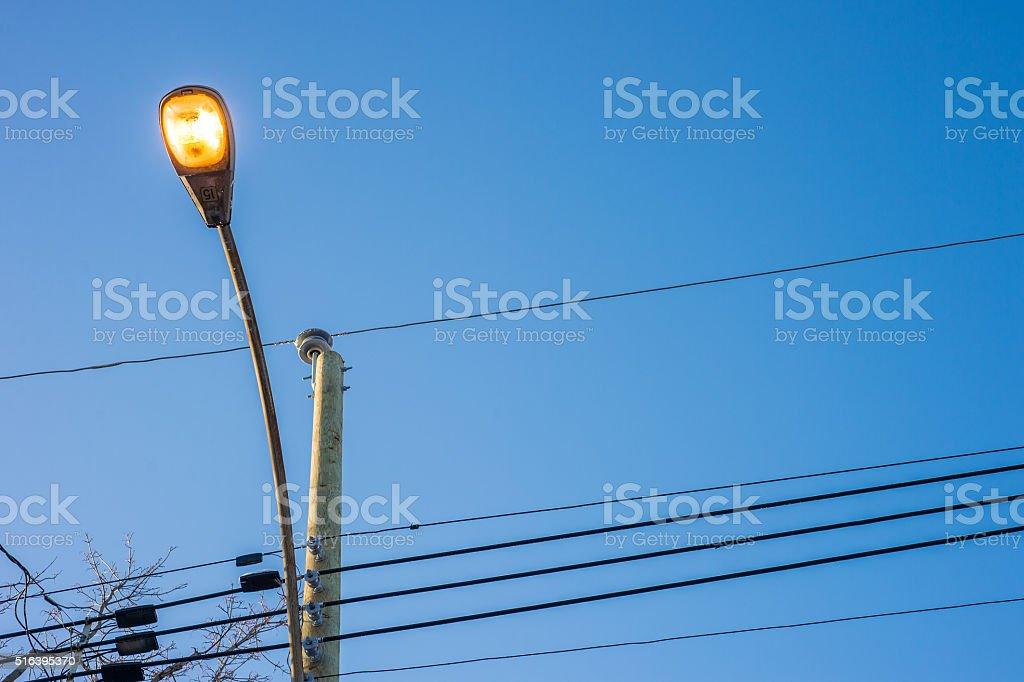Modern street lights illuminated in Montreal stock photo