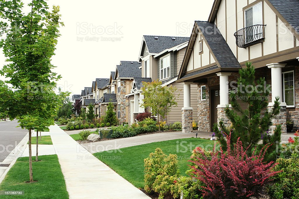 A modern street of new build houses stock photo