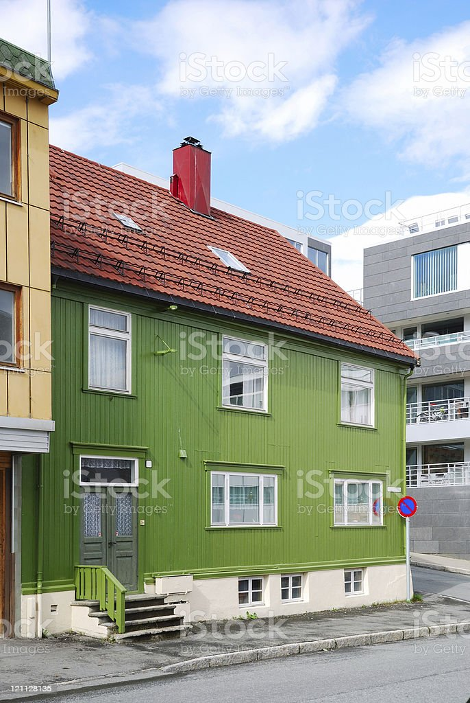 Modern street of Tromso with ancient house. stock photo