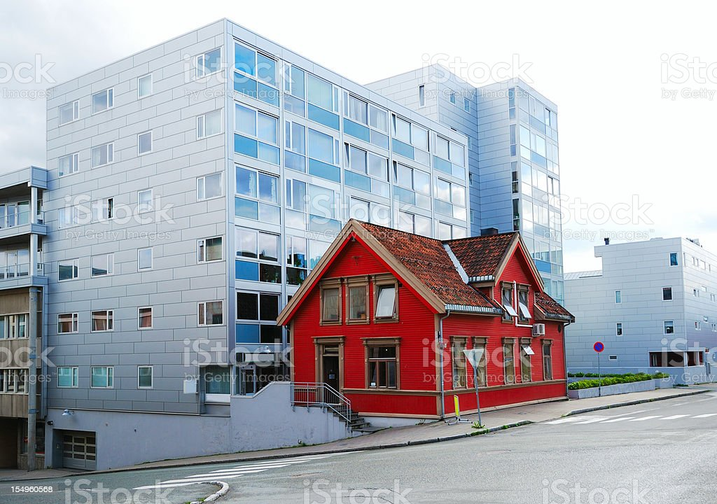 Modern street of Tromso with small ancient house. stock photo