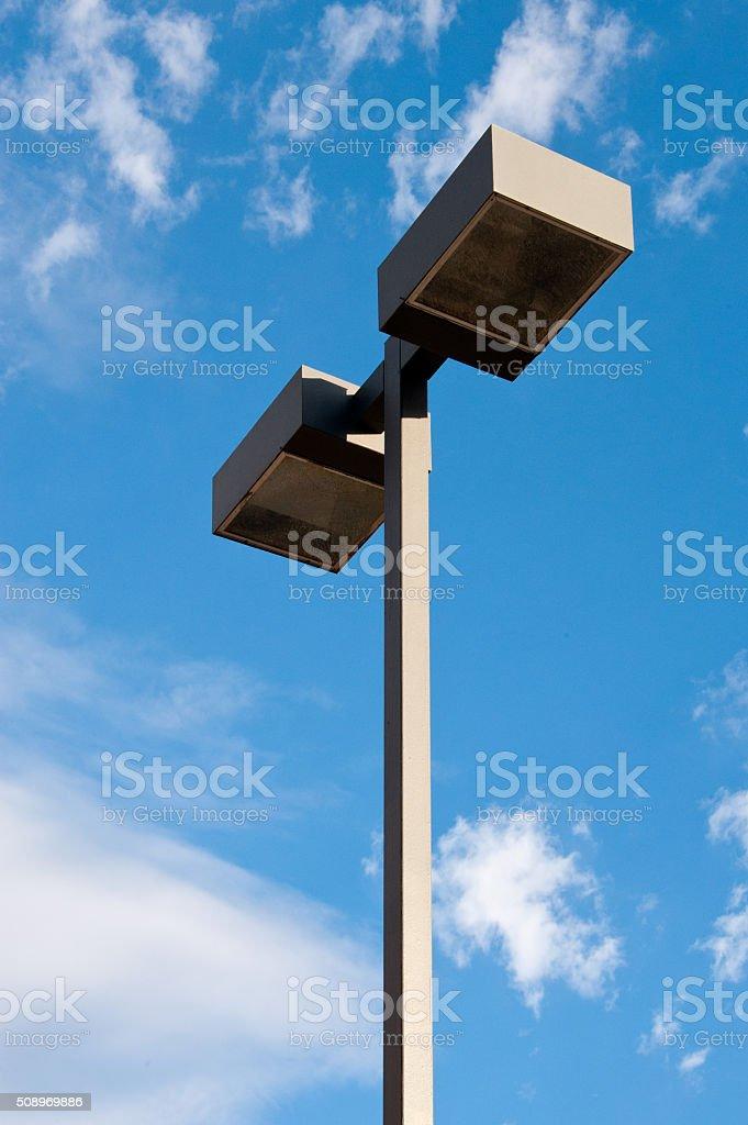 Modern Streetlight, Aluminum Downlight Luminaire Blue Sky, White Clouds stock photo