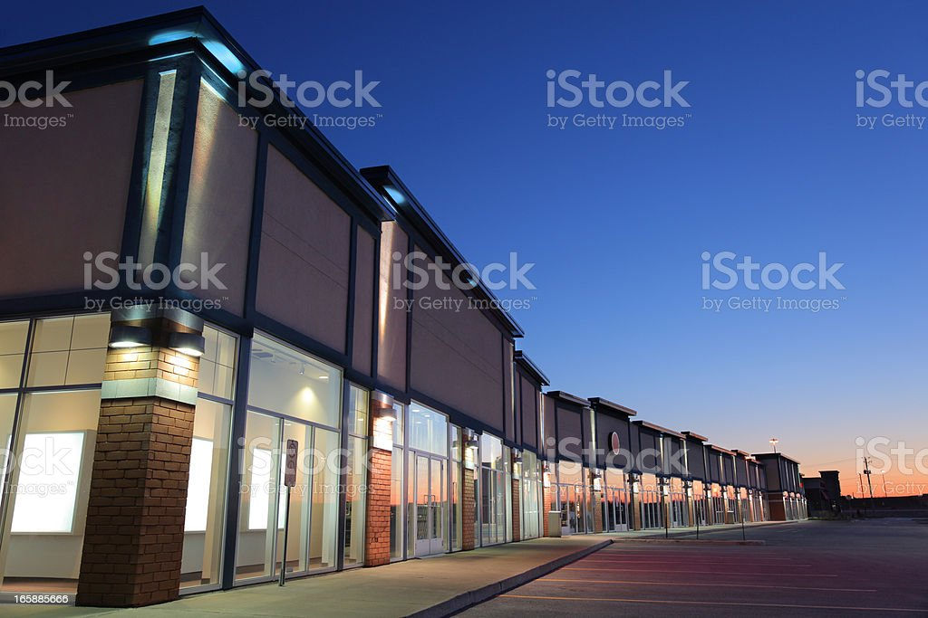 Modern Strip Mall Building Exteriors at Sunset stock photo
