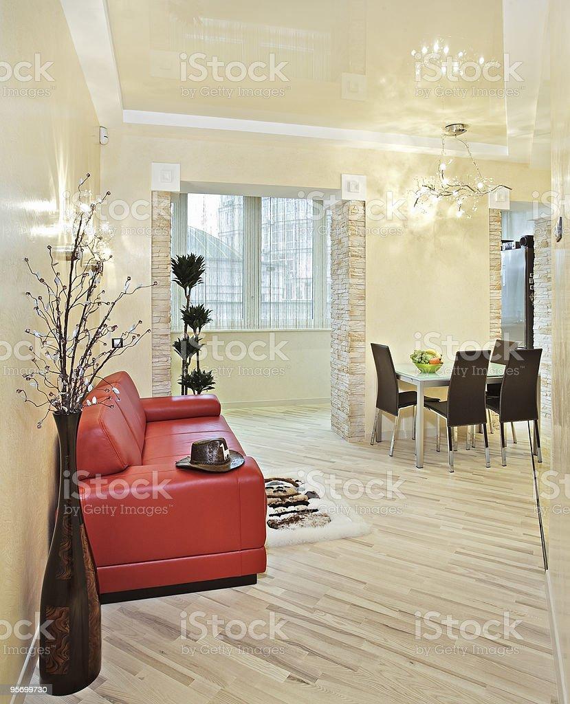 Modern studio interior with red sofa royalty-free stock photo