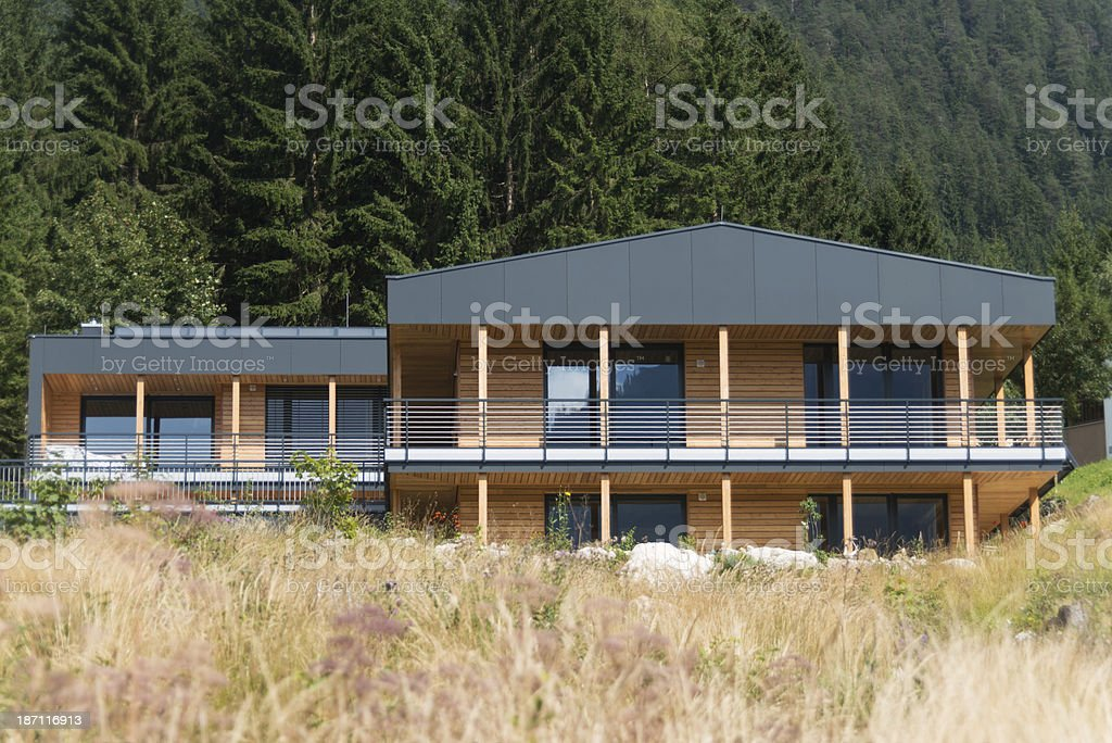 modern style architect house near forest on mountain stock photo