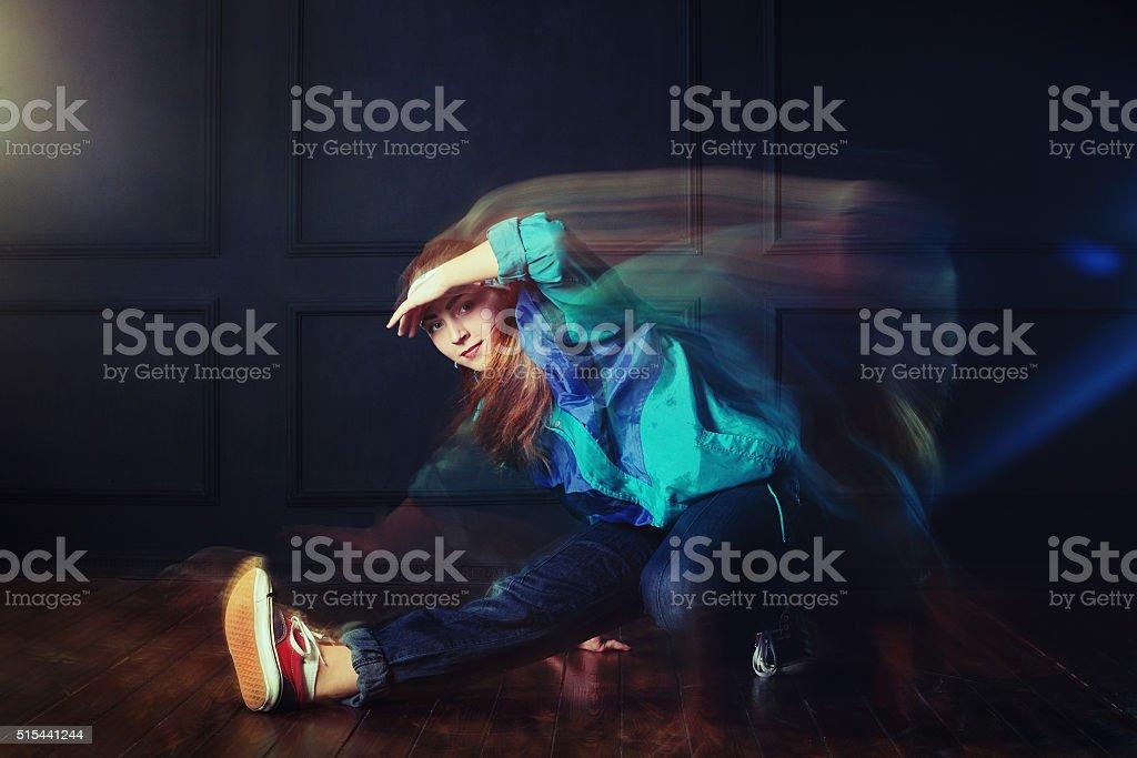 modern style dancer posing on studio background stock photo