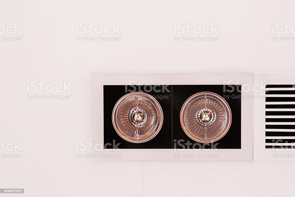 Modern style lighting fixtures on ceiling beside air grille stock photo