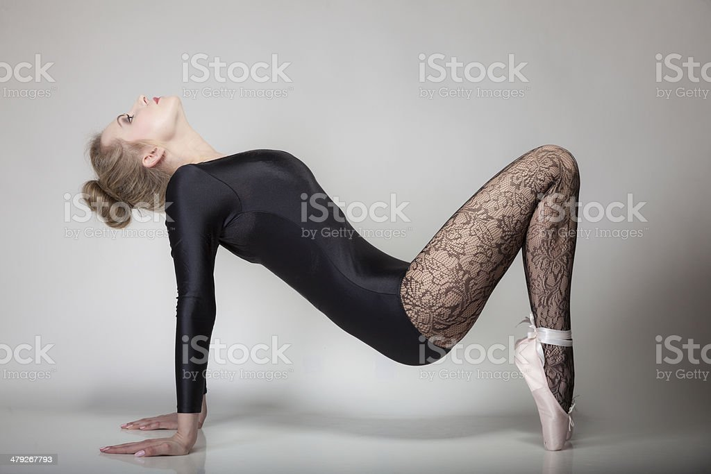 modern style woman ballet dancer full length on gray royalty-free stock photo