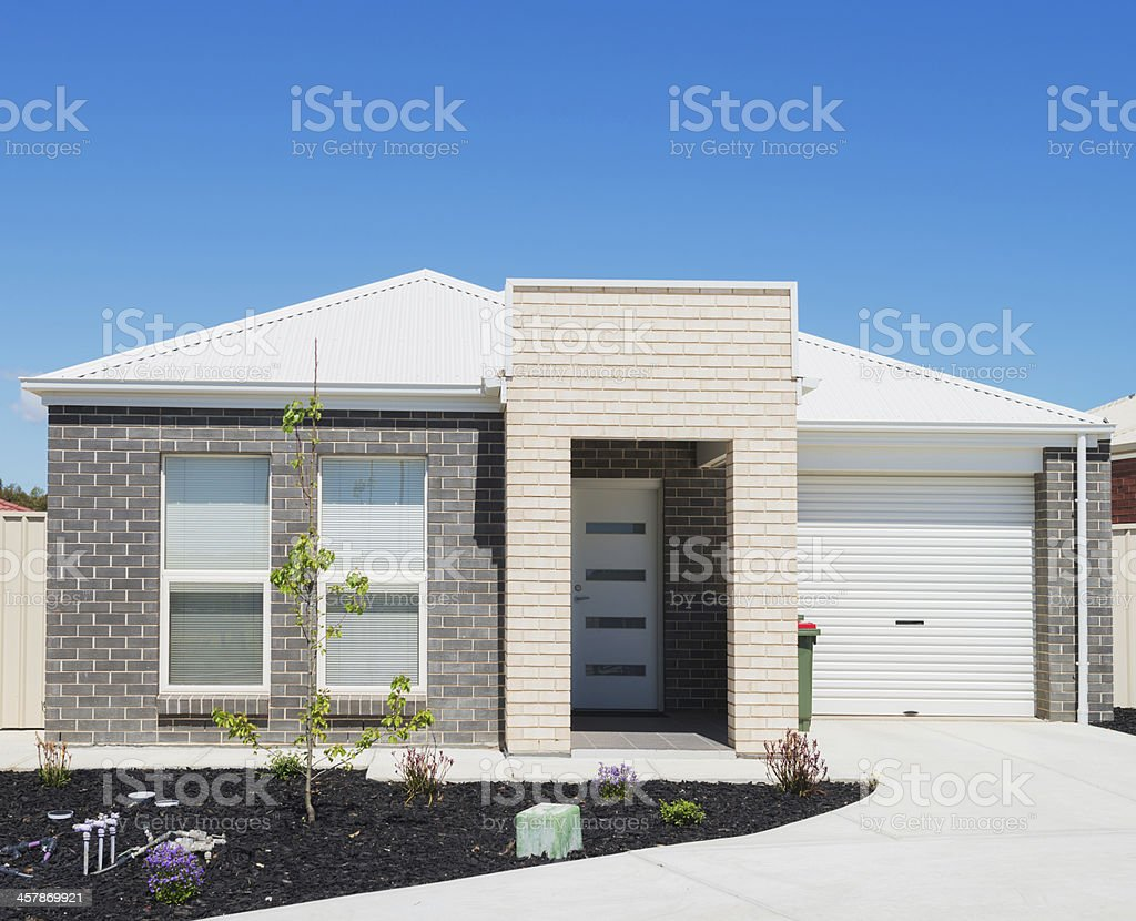 Modern suburban house with driveway royalty-free stock photo