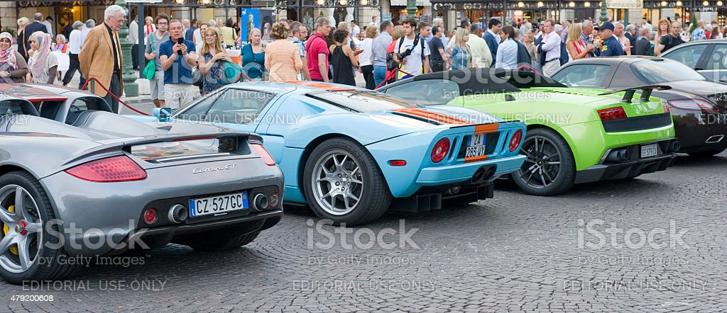 Modern Supercars Lined Up In Italy Rear View Stock Photo