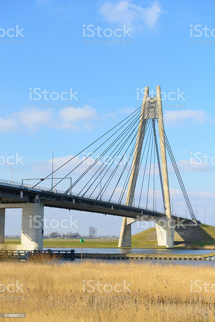 Modern suspension bridge over a river stock photo