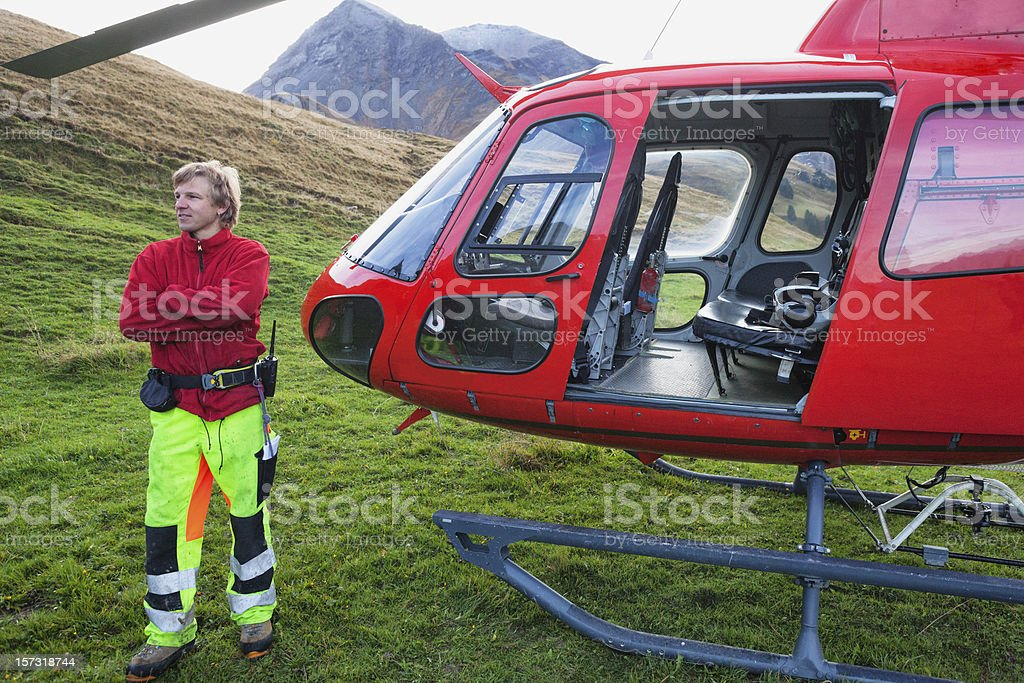 Modern Swiss Helicopter crew standing next to machine. royalty-free stock photo