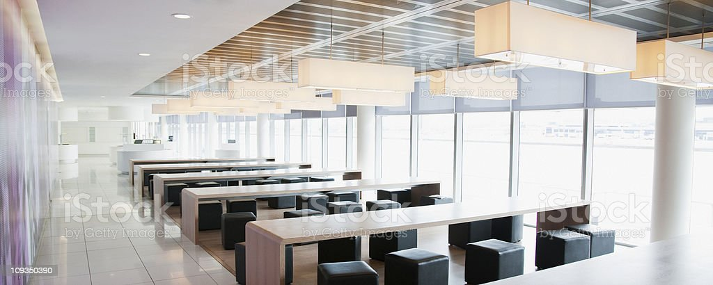 Modern tables and chairs in empty cafe royalty-free stock photo