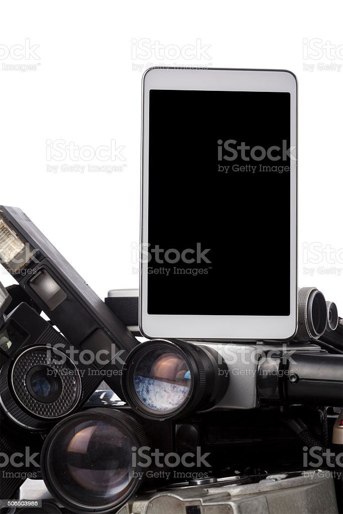 Modern Tablet Pc On Top Of Antique Cameras stock photo
