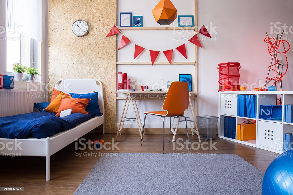 Modern teen boy bedroom stock photo