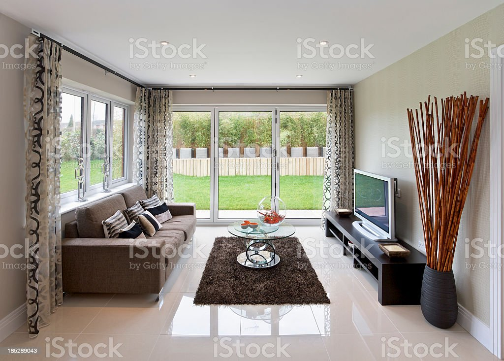 Modern television room with modern decor and large windows stock photo